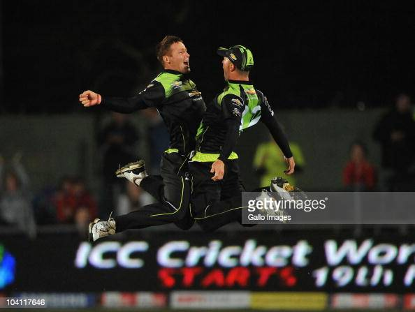 Rusty Theron and Davy Jacobs of the Warriors celebate victory during the Airtel Champions League Twenty20 match between Chevrolet Warriors and...
