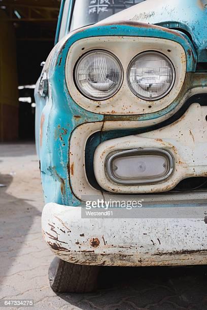 Rusty vintage car, partial view
