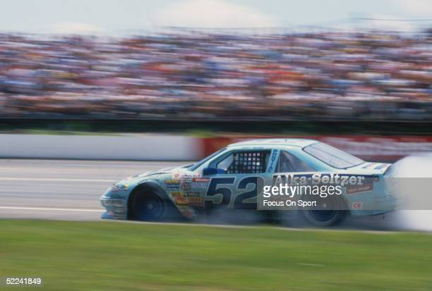 Rusty Wallace leaves a trail of smoke as he drives his AlkaSeltzer car infield