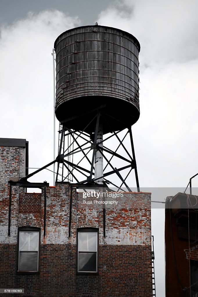 Rusty water tower on a roof in Manhattan, NYC