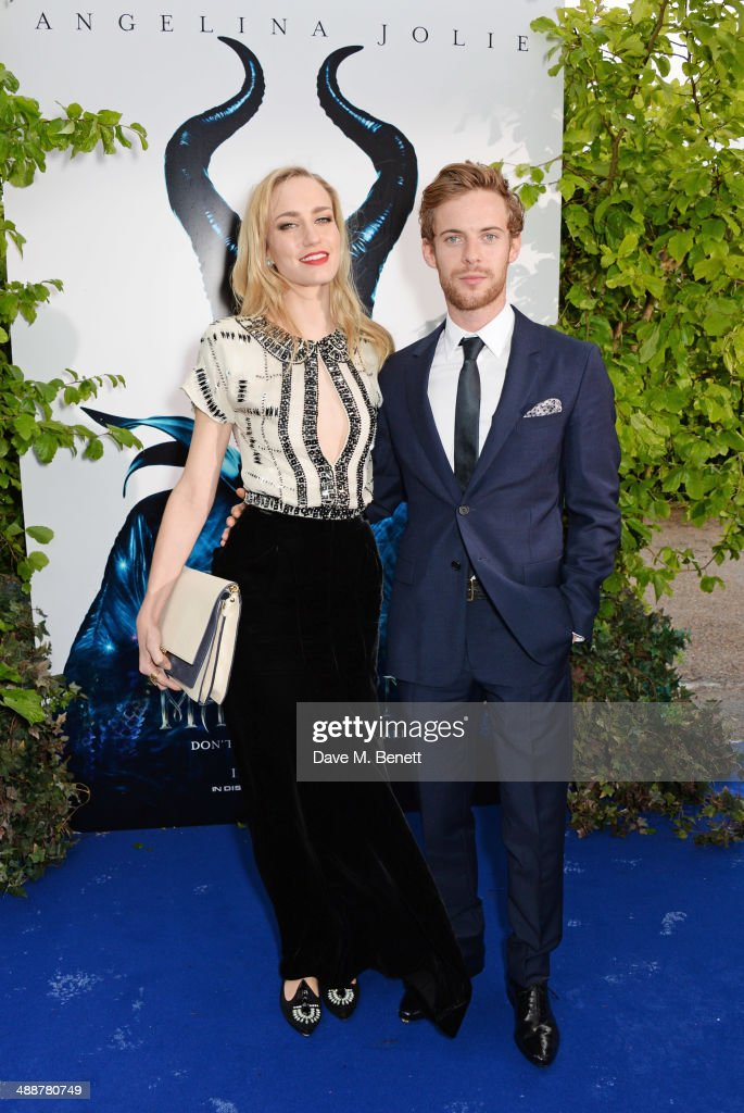 Ruta Gedmintas and Luke Treadaway arrive at a private reception as costumes and props from Disney's 'Maleficent' are exhibited in support of Great...