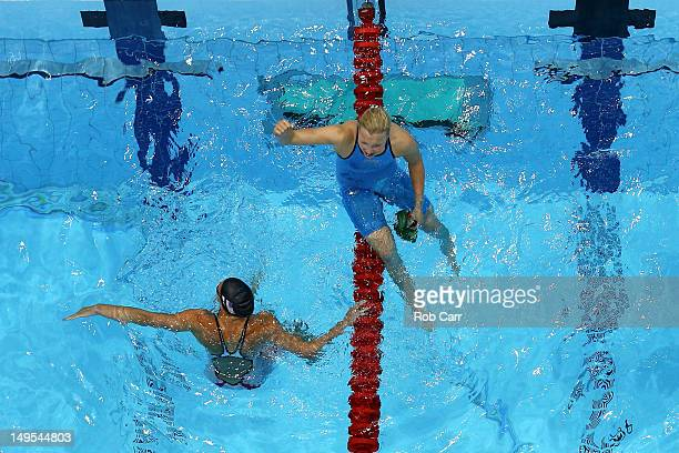 Ruta Meilutyte of Lithuania celebrates after she won the Final of the Women's 100m Breaststroke as Rebecca Soni of the United States looks on on Day...