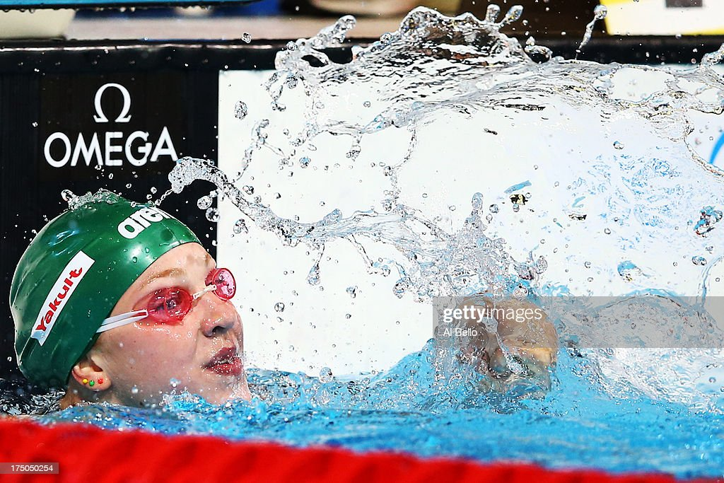 <a gi-track='captionPersonalityLinkClicked' href=/galleries/search?phrase=Ruta+Meilutyte&family=editorial&specificpeople=7539009 ng-click='$event.stopPropagation()'>Ruta Meilutyte</a> of Lithuania celebrates after the Swimming Women's 100m Breastroke Final on day eleven of the 15th FINA World Championships at Palau Sant Jordi on July 30, 2013 in Barcelona, Spain.