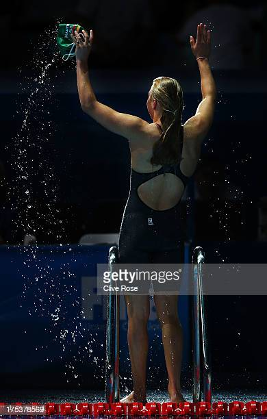 Ruta Meilutyte of Lithuania celebrates setting a new World Record time of 2948 in the Swimming Women's Breaststroke 50m Semifinal heat 2 on day...