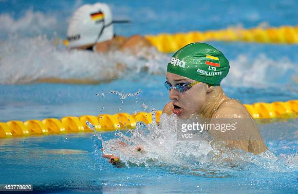 Ruta Meilutyte of Lithuania competes in the Women's 50m Breaststroke final match on day two of the Nanjing 2014 Summer Youth Olympic Games at Nanjing...