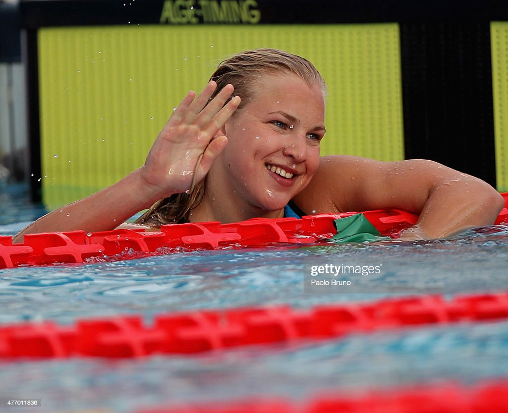 <a gi-track='captionPersonalityLinkClicked' href=/galleries/search?phrase=Ruta+Meilutyte&family=editorial&specificpeople=7539009 ng-click='$event.stopPropagation()'>Ruta Meilutyte</a> of Lithuania greets the fans after winning the women 50 m Breaststroke Final A during the International Settecolli Trophy at Piscine del Foro Italico on June 13, 2015 in Rome, Italy.