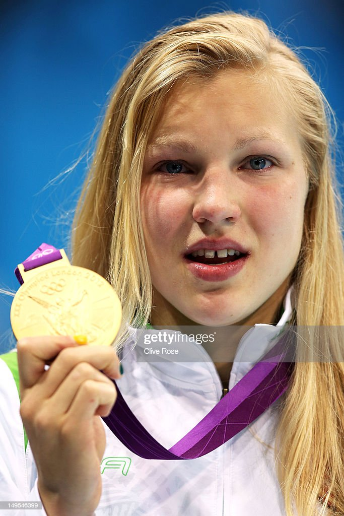 <a gi-track='captionPersonalityLinkClicked' href=/galleries/search?phrase=Ruta+Meilutyte&family=editorial&specificpeople=7539009 ng-click='$event.stopPropagation()'>Ruta Meilutyte</a> of Lithuania holds up her gold medal during the medal ceremony for the Women's 100m Breaststroke on Day 3 of the London 2012 Olympic Games at the Aquatics Centre on July 30, 2012 in London, England.