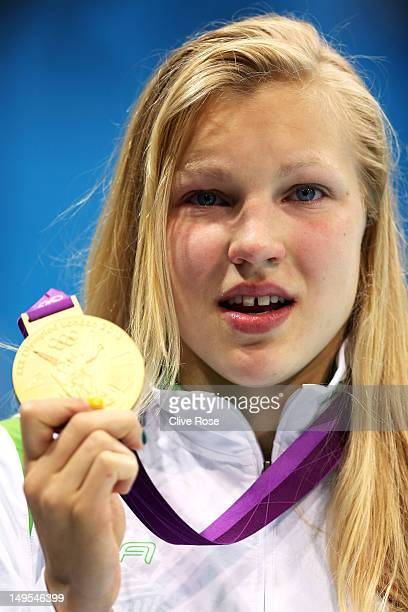 Ruta Meilutyte of Lithuania holds up her gold medal during the medal ceremony for the Women's 100m Breaststroke on Day 3 of the London 2012 Olympic...