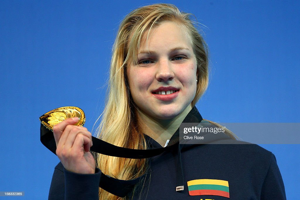 Ruta Meilutyte of Lithuania poses with her Gold medal on the podium after winning the Women's 50m Breaststroke Final during day two of the 11th FINA Short Course World Championships at the Sinan Erdem Dome on December 13, 2012 in Istanbul, Turkey.