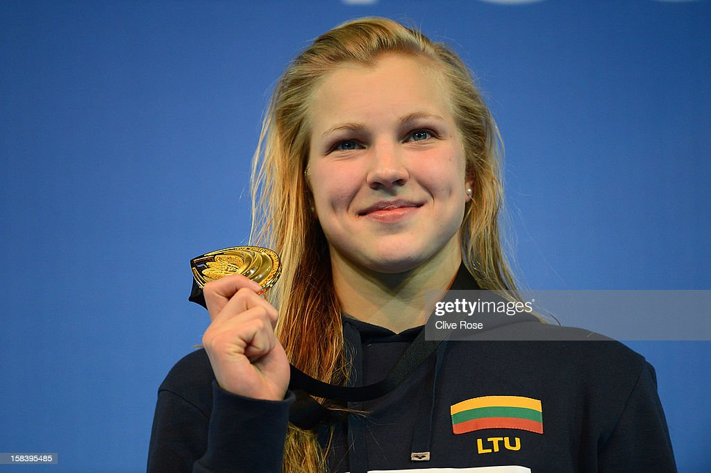 Ruta Meilutyte of Lithuania poses with her Gold medal on the podium after winning the Women's 100m Breaststroke Final during day four of the 11th FINA Short Course World Championships at the Sinan Erdem Dome on December 15, 2012 in Istanbul, Turkey.