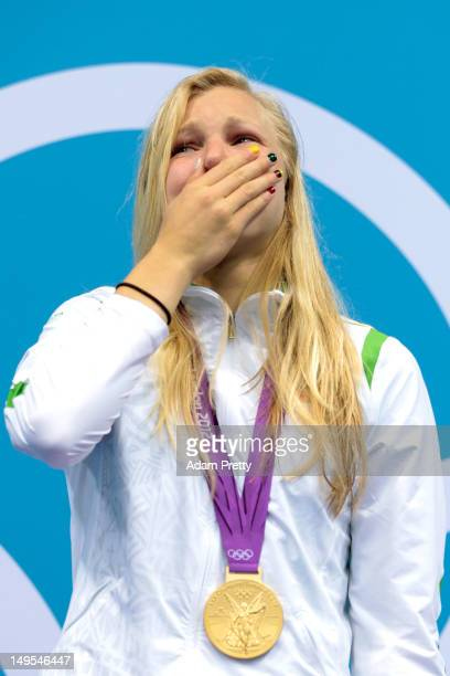 Ruta Meilutyte of Lithuania reacts with her gold medal during the medal ceremony for the Women's 100m Breaststroke on Day 3 of the London 2012...