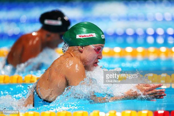 Ruta Meilutyte of Lithuania sets a new world record time of 10435 as she competes during the Swimming Women's 100m Breaststroke Semifinal 2 on day...