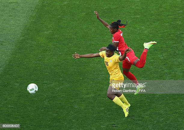 Rutendo Makore of Zimbabwe is challenged by Kadeisha Buchanan of Canada during the Women's First Round Group F match between Canada and Zimbabwe on...