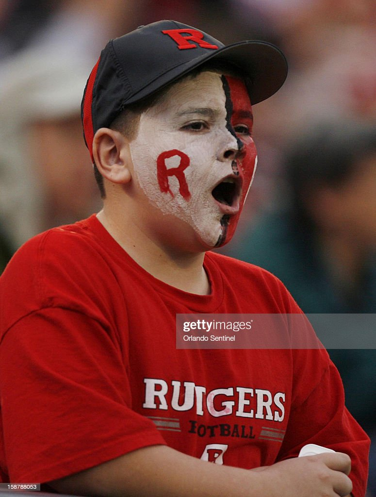 A Rutgers fan can only watch as Virginia Tech rallies for a 13-10 win in overtime during the Russell Athletic Bowl at the Florida Citrus Bowl in Orlando, Florida, on Friday, December 28, 2012.