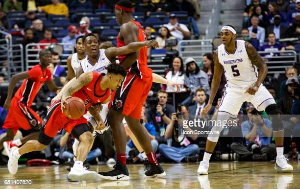 Rutgers Scarlet Knights guard Corey Sanders dribbles towards Northwestern Wildcats center Dererk Pardon during a Big 10 tournament secondround game...