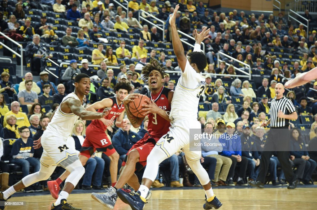 Rutgers Scarlet Knights guard Corey Sanders (3) drives the lane on Michigan Wolverines guard Zavier Simpson (3) during the Michigan Wolverines game versus the Rutgers Scarlet Knights on Sunday January 21, 2018 at Crisler Center Field in Ann Arbor, MI.