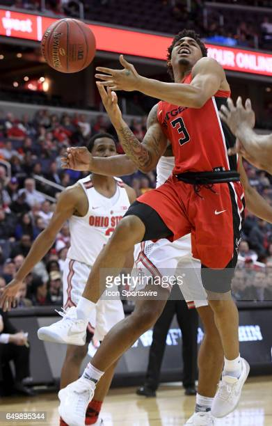 Rutgers Scarlet Knights guard Corey Sanders is fouled going to the basket in the second half against the Ohio State Buckeyes during the first round...