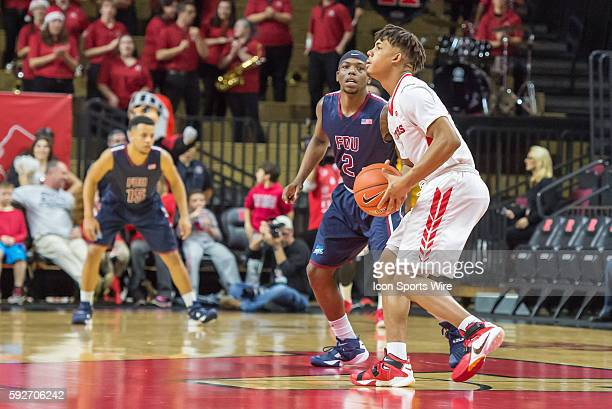 Rutgers Scarlet Knights guard Corey Sanders looks toppers the ball as Fairleigh Dickinson Knights guard Darian Anderson defends 22during the NCAA...