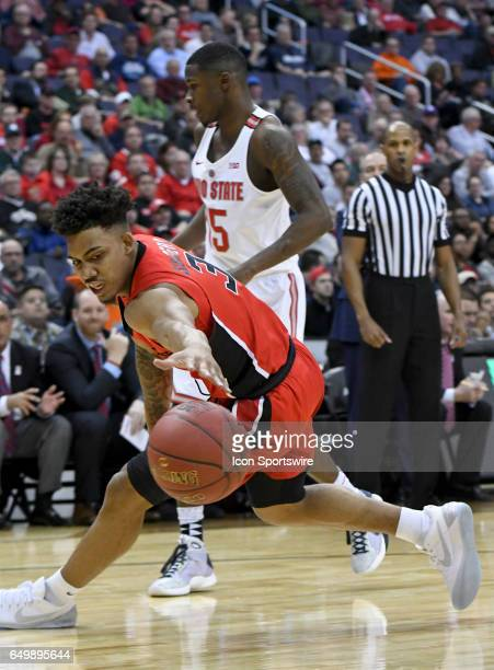 Rutgers Scarlet Knights guard Corey Sanders looses the ball against Ohio State Buckeyes guard Kam Williams during the first round of the Big 10...