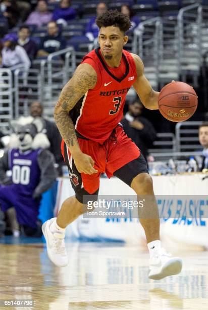 Rutgers Scarlet Knights guard Corey Sanders moves up court during a Big 10 tournament secondround game between the Northwestern Wildcats and the...