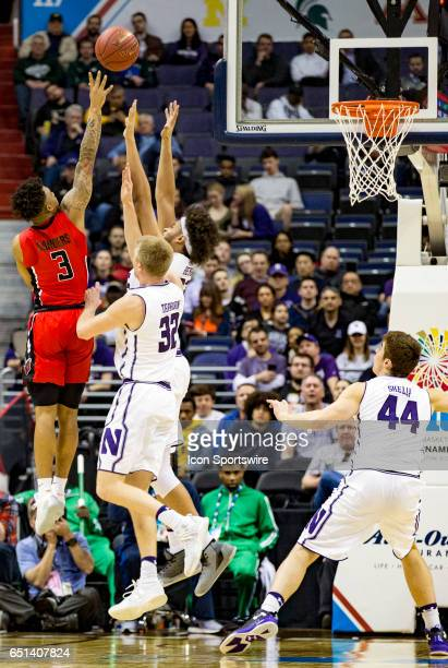 Rutgers Scarlet Knights guard Corey Sanders shoots over Northwestern Wildcats forward Nathan Taphorn Northwestern Wildcats center Barret Benson...