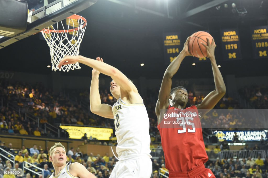 Rutgers Scarlet Knights guard Issa Thiam (35) takes this rebound away from Michigan Wolverines guard Duncan Robinson (22) during the Michigan Wolverines game versus the Rutgers Scarlet Knights on Sunday January 21, 2018 at Crisler Center Field in Ann Arbor, MI.