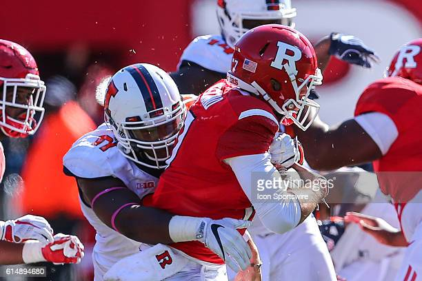 Rutgers Scarlet Knights quarterback Giovanni Rescigno gets sacked by Illinois Fighting Illini defensive lineman Dawuane Smoot during the game between...