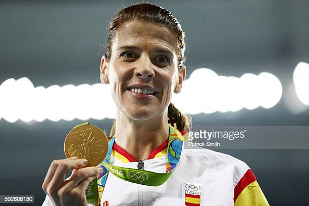 Ruth Beitia of Spain stands on the podium during the medal ceremony for the Women's High Jump on Day 15 of the Rio 2016 Olympic Games at the Olympic...