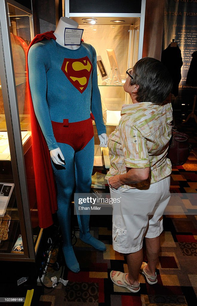 Ruth Borton of Nevada looks at items, including actor Christopher Reeve's costume from the movie, 'Superman
