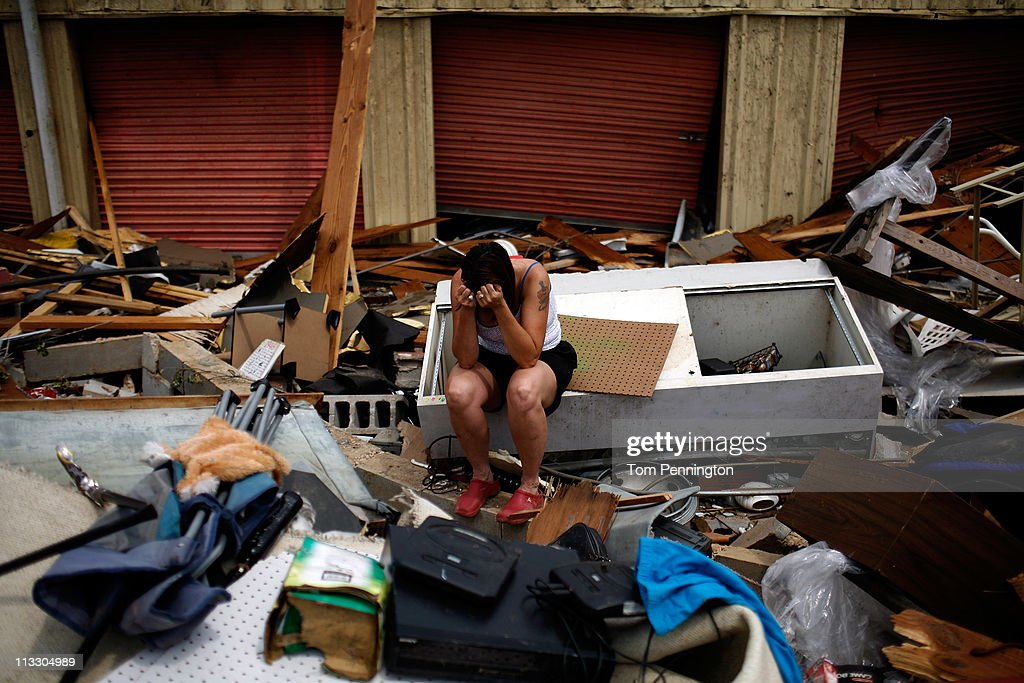 Ruth Cole becomes emotional while digging through her destroyed business on May 1, 2011 in Tuscaloosa, Alabama. Cole had no insurance on her business or her home, which was also destroyed in the storm. Alabama, the hardest-hit of six states, is reported to have been battered with at least an EF-4 rated tornado with the death toll across the South rising to over 300 as a result of the storms.