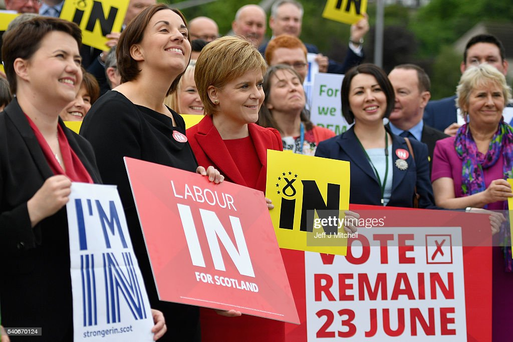 Ruth Davidson leader of Scottish Conservatives, Kezia Dugdale leader of Scottish Labour and Scottish First Minister, Nicola Sturgeon pose with supporting MSP's as they gather outside the Scottish Parliament with vote remain EU banners on June 16, 2016 in Edinburgh, Scotland. With one week to go before the EU referendum on June 23rd campaigning by the 'In' and 'Out' campaigns are stepping up a gear. (