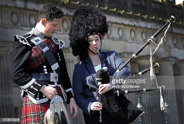 Ruth Davidson leader of the Scottish Conservatives plays the bagpipes next to piper Peter Wade as she campaigns for the UK general election in the...