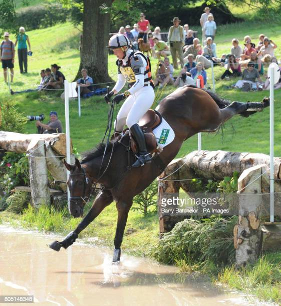 Ruth Edge and Two Thyme jump into the lake at the BETA Water during the Open Section during the Festival of British Eventing at Gatcombe Park Stroud