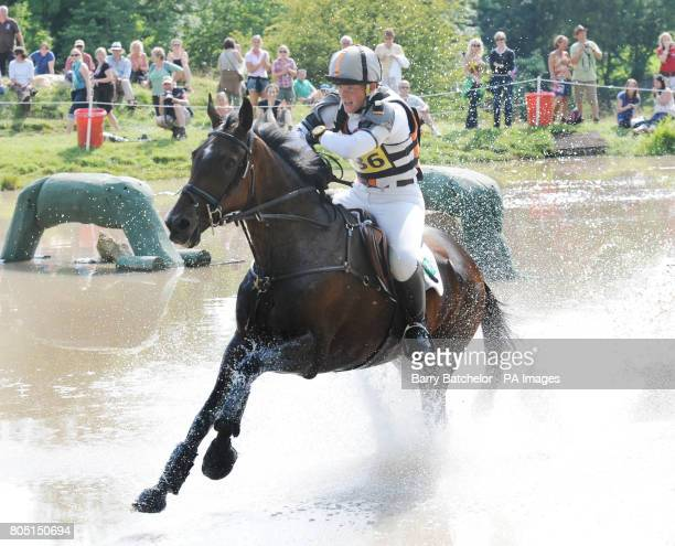 Ruth Edge rides Two Thyme through the lake at the BETA water during the Open Section of the Festival of British Eventing at Gatcombe Park Stroud