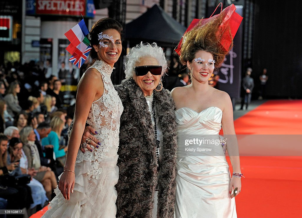 <a gi-track='captionPersonalityLinkClicked' href=/galleries/search?phrase=Ruth+Flowers&family=editorial&specificpeople=5862454 ng-click='$event.stopPropagation()'>Ruth Flowers</a> (C) of Mamy Rock poses with models on the runway during the world's biggest fashion show '2nd edition' at Galeries Lafayette where the Guinness World Record for the most people to walk in a runway show was broken at Galeries Lafayette on September 15, 2011 in Paris, France.