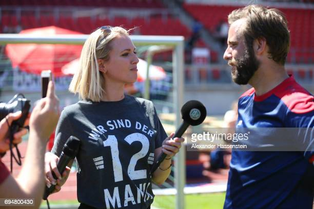Ruth Hofmann interviews to a player during the DFB Cup Der Fans 2017 at Stadion Nuernberg on June 11 2017 in Nuremberg Germany