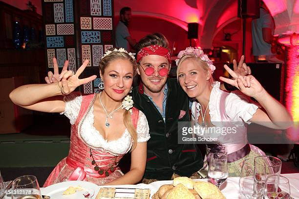 Ruth Moschner Steffen Bruhn Andrea Arland attend the Dresscoded Hippie Wiesn 2014 at Golfclub Gut Thailing on August 28 2014 in Steinhoering near...
