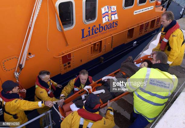 Ruth Perl is carried from the Torbay lifeboat to a waiting ambulance at Torquay harbour after she and another woman were evacuated from the 550...
