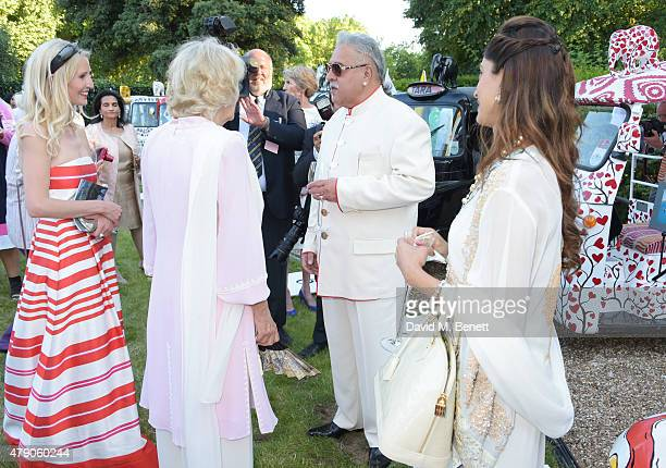 Ruth Powys Camilla Duchess of Cornwall and Vijay Mallya attends the Quintessentially Foundation and Elephant Family's Royal Rickshaw Auction...