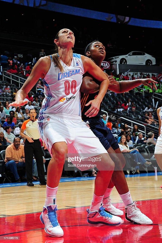 <a gi-track='captionPersonalityLinkClicked' href=/galleries/search?phrase=Ruth+Riley&family=editorial&specificpeople=203333 ng-click='$event.stopPropagation()'>Ruth Riley</a> #00 of the Atlanta Dream boxes out against Sasha Goodlett #45 of the Indiana Fever at Philips Arena on June 25, 2013 in Atlanta, Georgia.