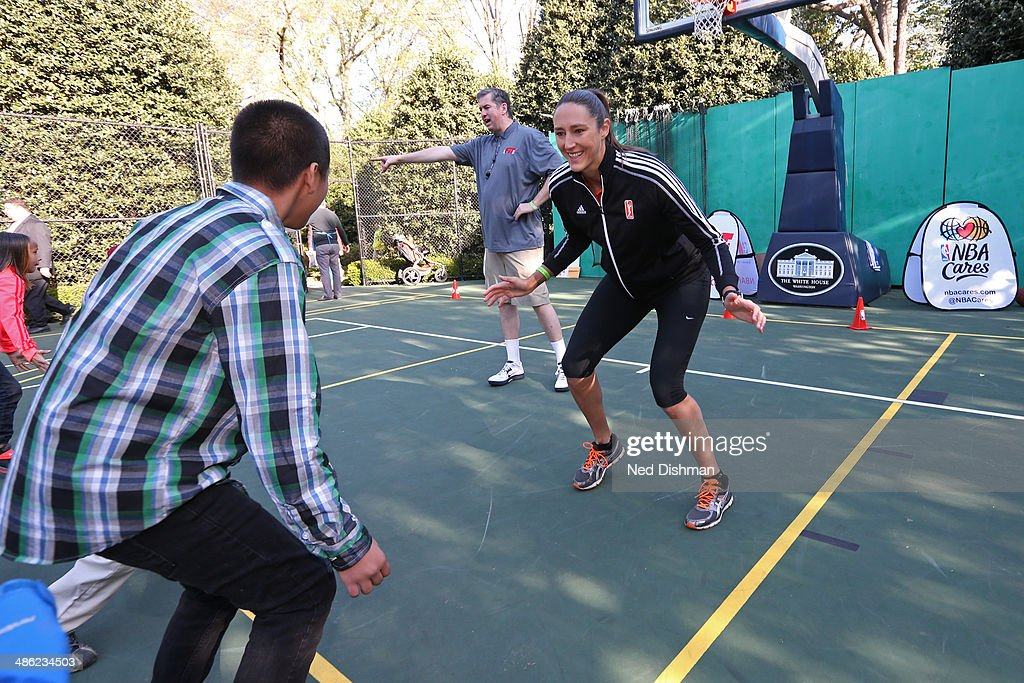 Ruth Riley #00 of the Atlanta Dream coaches during an NBA Fit Clinic at the 2014 White House Easter Egg Roll on April 21, 2014 in Washington, DC.