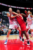 Ruth Riley of the Atlanta Dream fights for position against Crystal Langhorne of the Washington Mystics during Game three Eastern Conference...