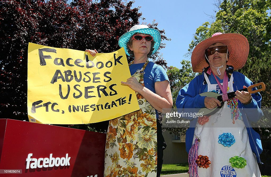 Ruth Robertson (L) and Shirley Powers of the group Raging Grannies stage a demonstration outside of the FaceBook headquarters June 4, 2010 in Palo Alto, California. The group was calling for the FTC to investigate FaceBook's privacy policies.