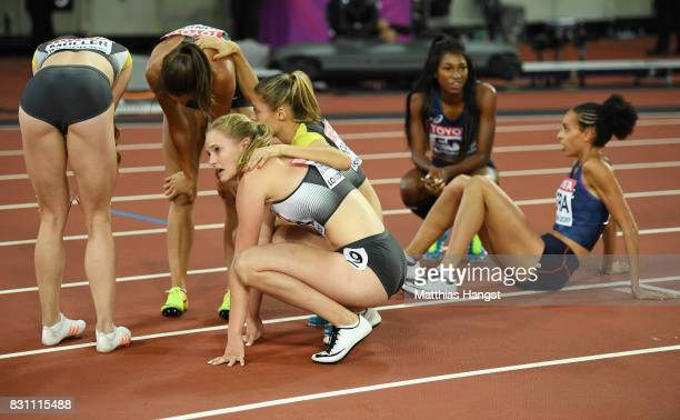 Ruth Sophia Spelmeyer Laura Muller Nadine Gonska and Hannah Mergenthaler of Germany react after they placed last in the Women's 4x400 Metres Relay...