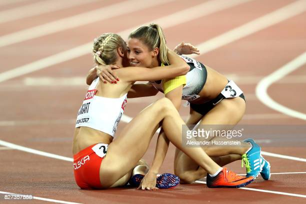 Ruth Sophia Spelmeyer of Germany and Iga Baumgart of Poland react after competing in the Women's 400 metres semi finals during day four of the 16th...