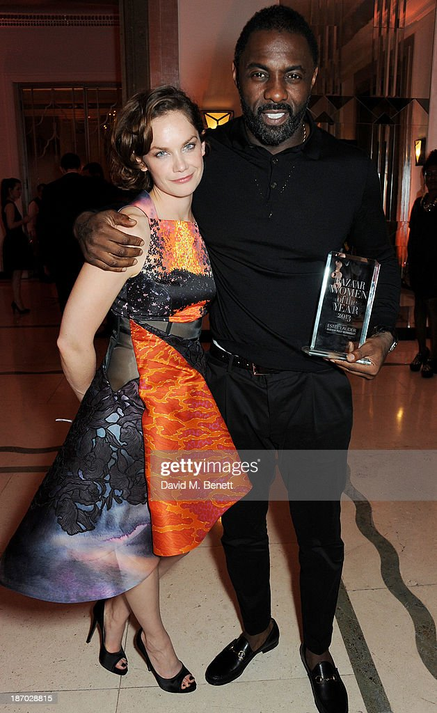 Ruth Wilson (L) and Idris Elba, winner of the Man of the Year award, attend the Harper's Bazaar Women of the Year awards at Claridge's Hotel on November 5, 2013 in London, England.