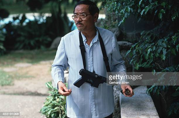 Ruther Batuigas at his house in Manila with his Uzi machine gun Now a criminal reporter Ruther was once a bounty hunter and owner of Bulls Eye a...