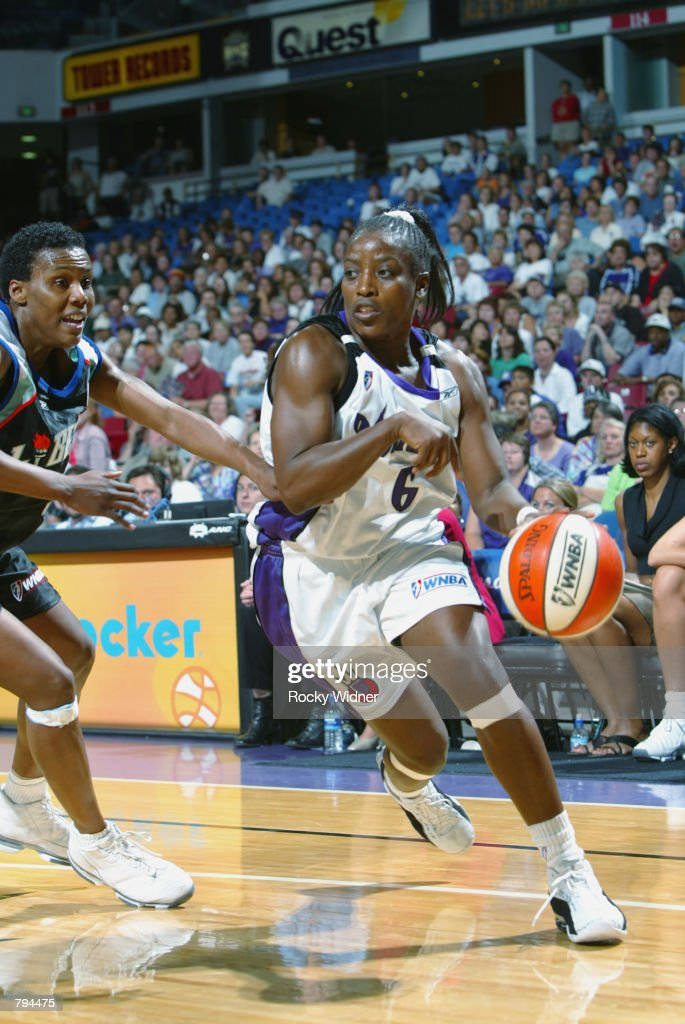 Ruthie Bolton of the Sacramento Monarchs drives past Crystal Robinson of the New York Liberty during the game at Arco Arena in Sacramento California...