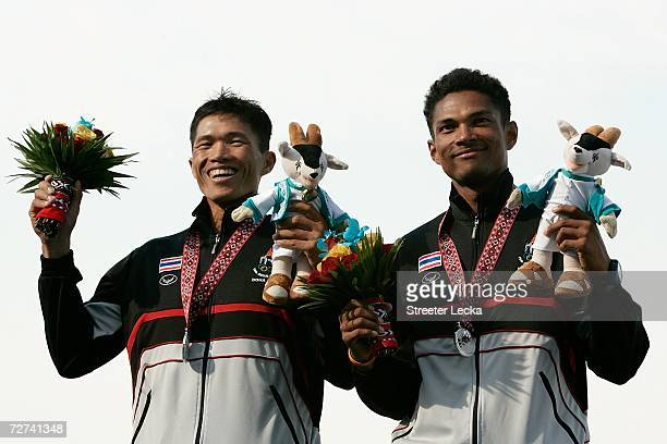 Ruthtanaphol Theppibal and Anupong Thainjam of Team Thailand wave to the crowd after winning the Silver Medal in the Men's Lightweight Double Sculls...