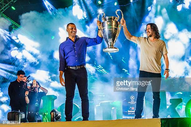 Ruud Gullit and Carles Puyol hold the UEFA trophy at the UEFA Champions League Trophy Tour on April 8 2016 in Ho Chi Minh City Vietnam